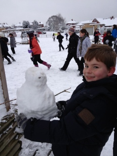 This snowman certainly likes his photo taken!